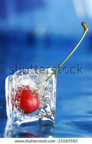 Cherry in an ice cube - stock photo
