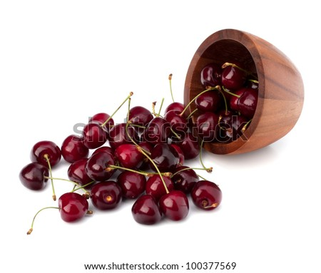 Cherry in wooden bowl isolated on white background - stock photo