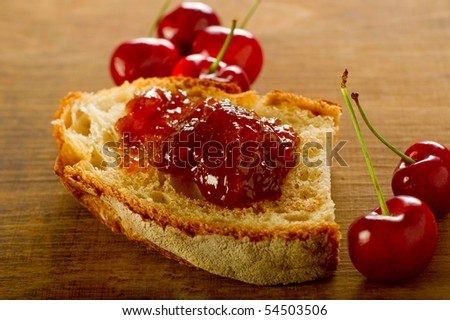 cherry jam aver slice bread - stock photo