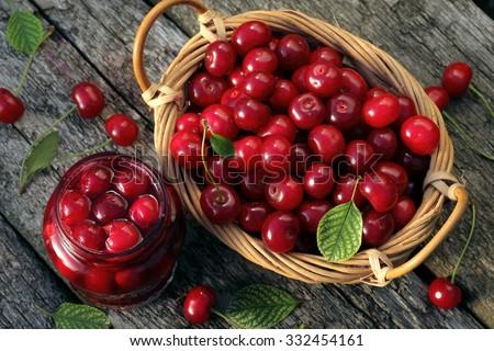 Cherry jam/ cherry  basket /  fresh cherries  background/  top view - stock photo