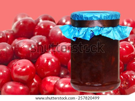 Cherry jam jar taken closeup on a ripe berries background. - stock photo