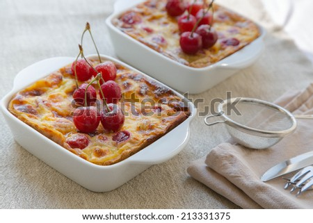 Cherry mini pies in the ceramic baking mold on the linen cloth - stock photo