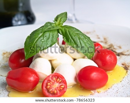 cherry mozzarella caprese, with tomatoes, oil and basil - stock photo