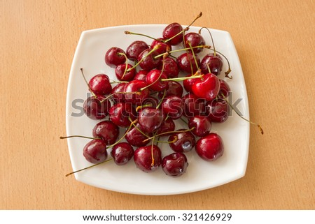 Cherry on white square plate