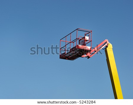 Cherry picker isolated on blue sky.