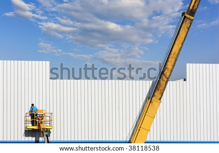 cherry picker on a construction site - stock photo