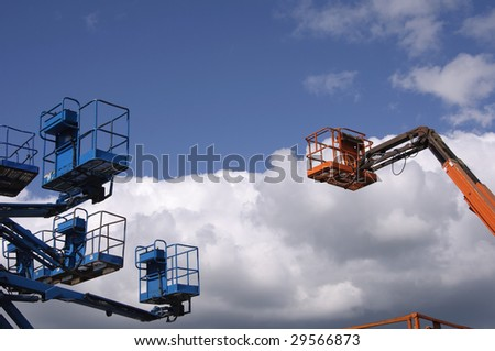 cherry pickers into the sky - stock photo