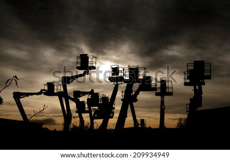 Cherry pickers lifting platform - stock photo