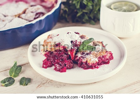 Cherry pie and a cup of tea. Rustic style. Berry pie. Homemade cherry pie with flaky crust, cup of coffee, bowl with cherries - stock photo