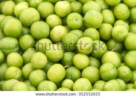 Cherry plum tkemali at farmers market stall. - stock photo