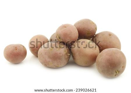 Cherry potatoes (small dutch potatoes) on a white background - stock photo