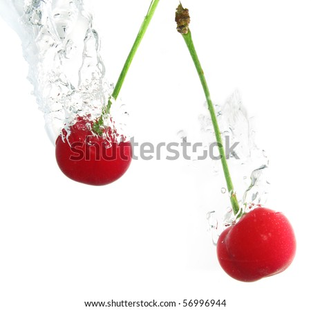 Cherry splashed into water - stock photo