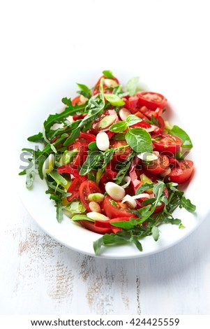 Cherry Tomato and Arugula Salad with Spring Onion - stock photo