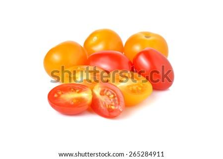 cherry tomato and yellow plum tomato on white background - stock photo