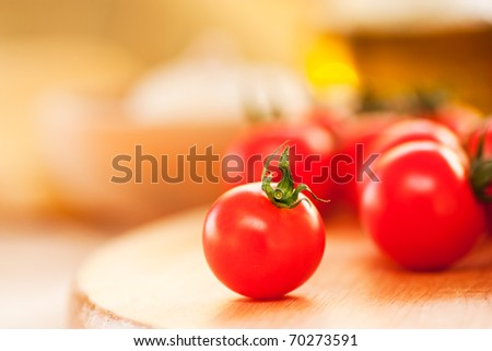 Cherry tomato on a wooden board. Shallow depth of field - stock photo