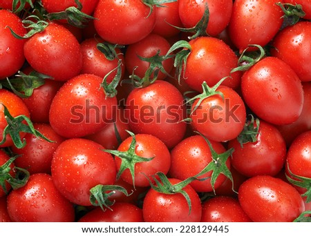 Cherry tomato Raw fruit and vegetable backgrounds overhead perspective, part of a set collection of healthy organic fresh produce - stock photo