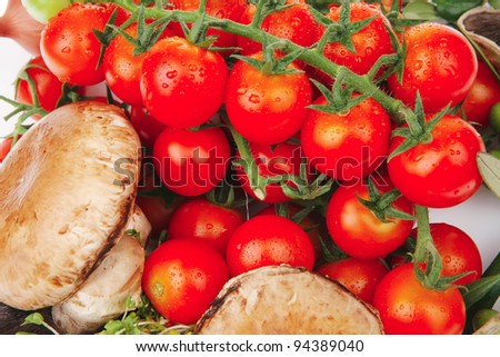cherry tomato with mushroom and olives over white