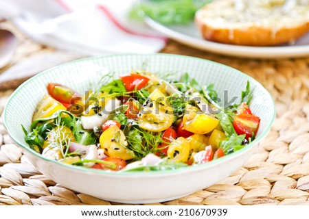 Cherry Tomato with sesame and Rocket salad by Baguette melted cheese