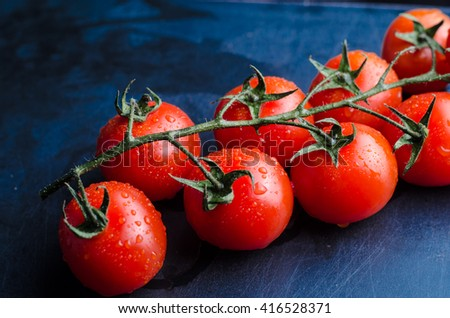 cherry tomato with water drops - stock photo