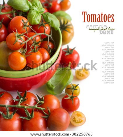 Cherry tomatoes and basil in bowl isolated on white background