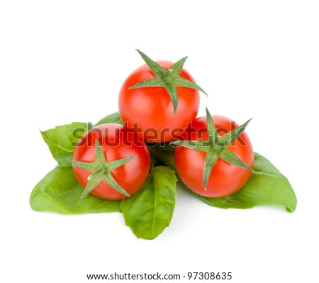Cherry tomatoes and basil leafs. Isolated on white background