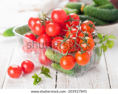 cherry tomatoes and cucumber in bowl, selective focus