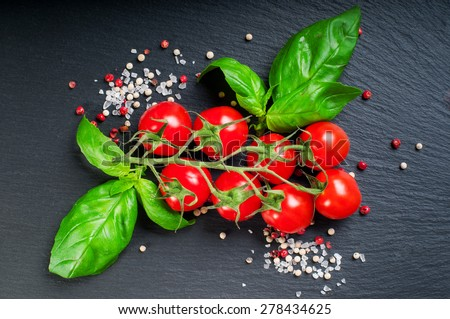 Cherry tomatoes and fresh ingredients - stock photo