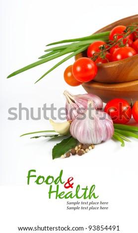 Cherry tomatoes and garlic on white background. - stock photo