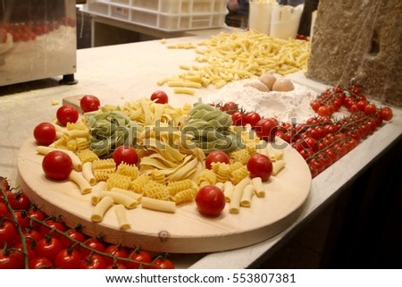 cherry tomatoes and pasta on a pasta factory