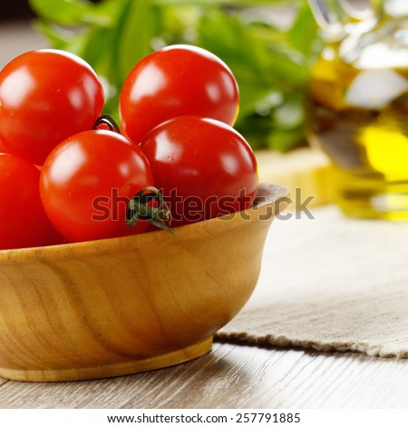 Cherry tomatoes, basil leaves and olive oil - for caprese salad - stock photo