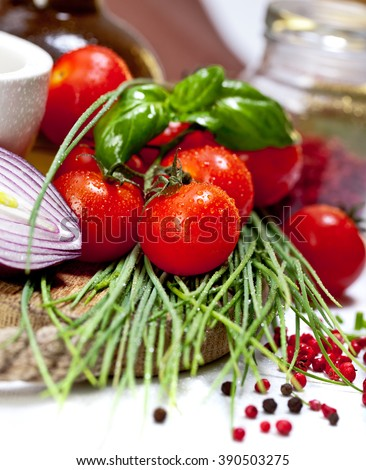 Cherry Tomatoes, chives and peppers on white - stock photo