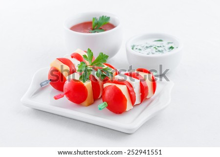 cherry tomatoes finger food on sticks - stock photo