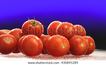 CHERRY TOMATOES , FRESH , RAW AND WASHED , ON GRADIENT BACKGROUND - stock photo