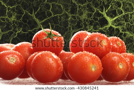 CHERRY TOMATOES , FRESH , RAW AND WASHED , ON ROOT - LIKE BACKGROUND - stock photo