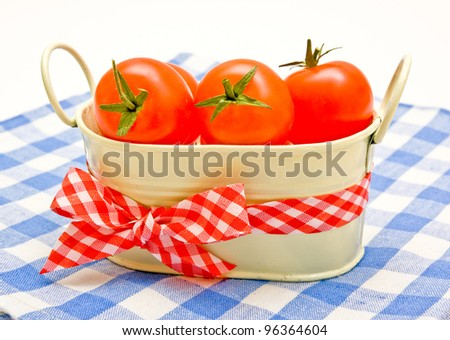 Cherry tomatoes in a bucket with a bow