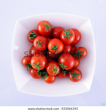 Cherry tomatoes in a white plate - stock photo