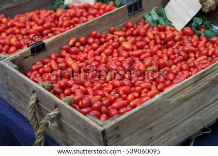 Cherry tomatoes in a wooden crate