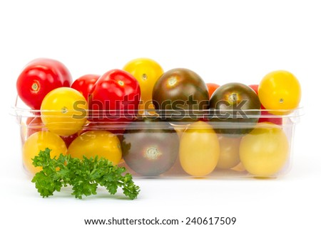 cherry tomatoes in plastic container  - stock photo
