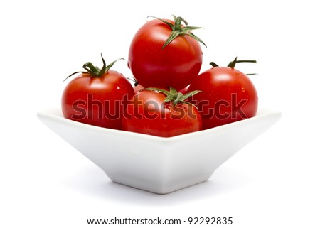 Cherry tomatoes in square bowl over white - stock photo