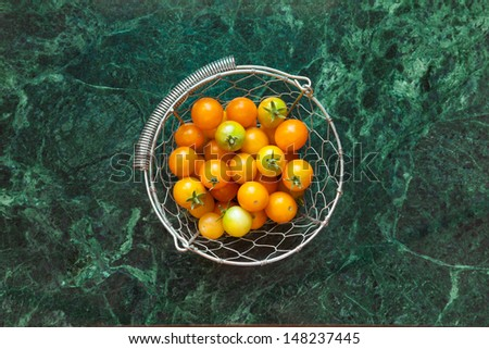 Cherry Tomatoes in Wire Basket - stock photo