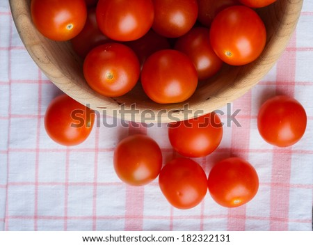 cherry tomatoes in wooden bowl - stock photo