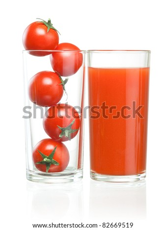 Cherry tomatoes inside of a glass and tomato juice - stock photo