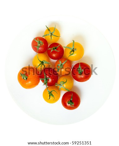 cherry tomatoes on a white plate from above, isolated on white - stock photo