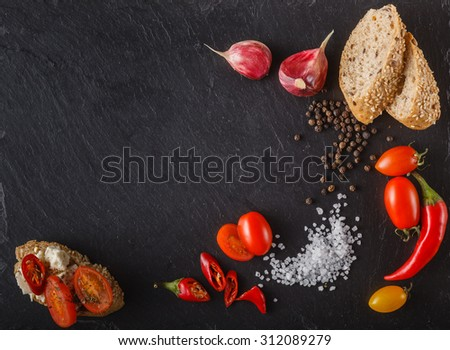 cherry tomatoes on slate with sliced bread, bruschetta  and salt. Place to inscription - stock photo