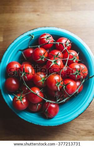 Cherry tomatoes on the vine - stock photo