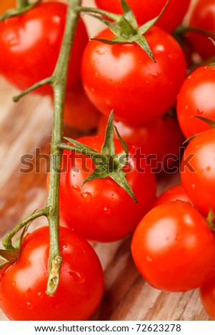 Cherry tomatoes on the wood background - stock photo