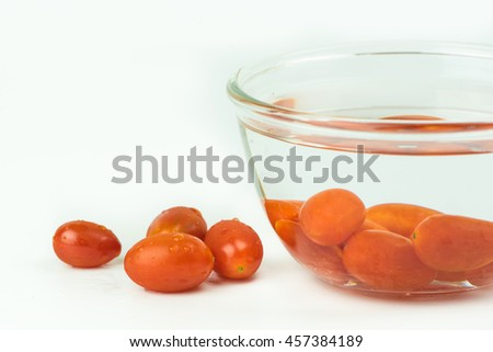 Cherry tomatoes on white background.