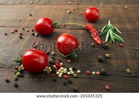 Cherry tomatoes on wooden table, low depth of focus - stock photo