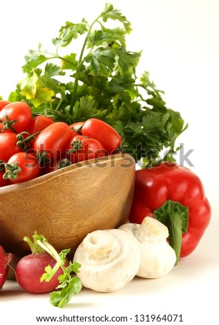 cherry tomatoes, radishes, peppers and parsley - assorted vegetables - stock photo