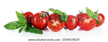 Cherry tomatoes with basil isolated on white - stock photo